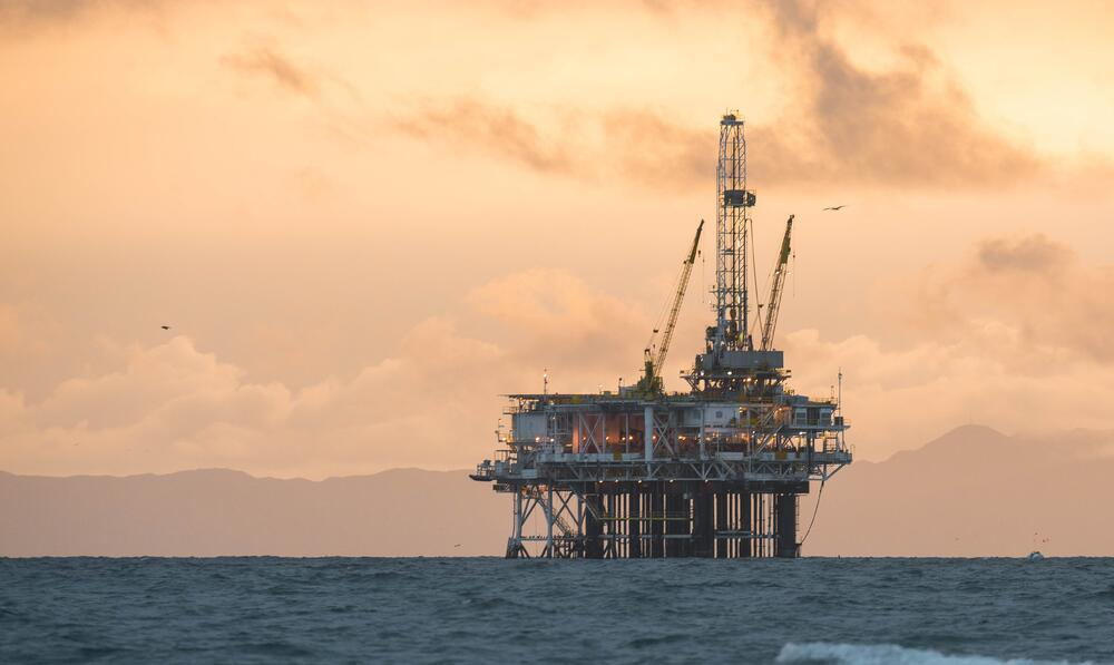 oil rig mountains and clouds