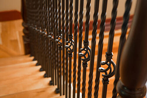 Iron balusters with a twisted basket design on staircase