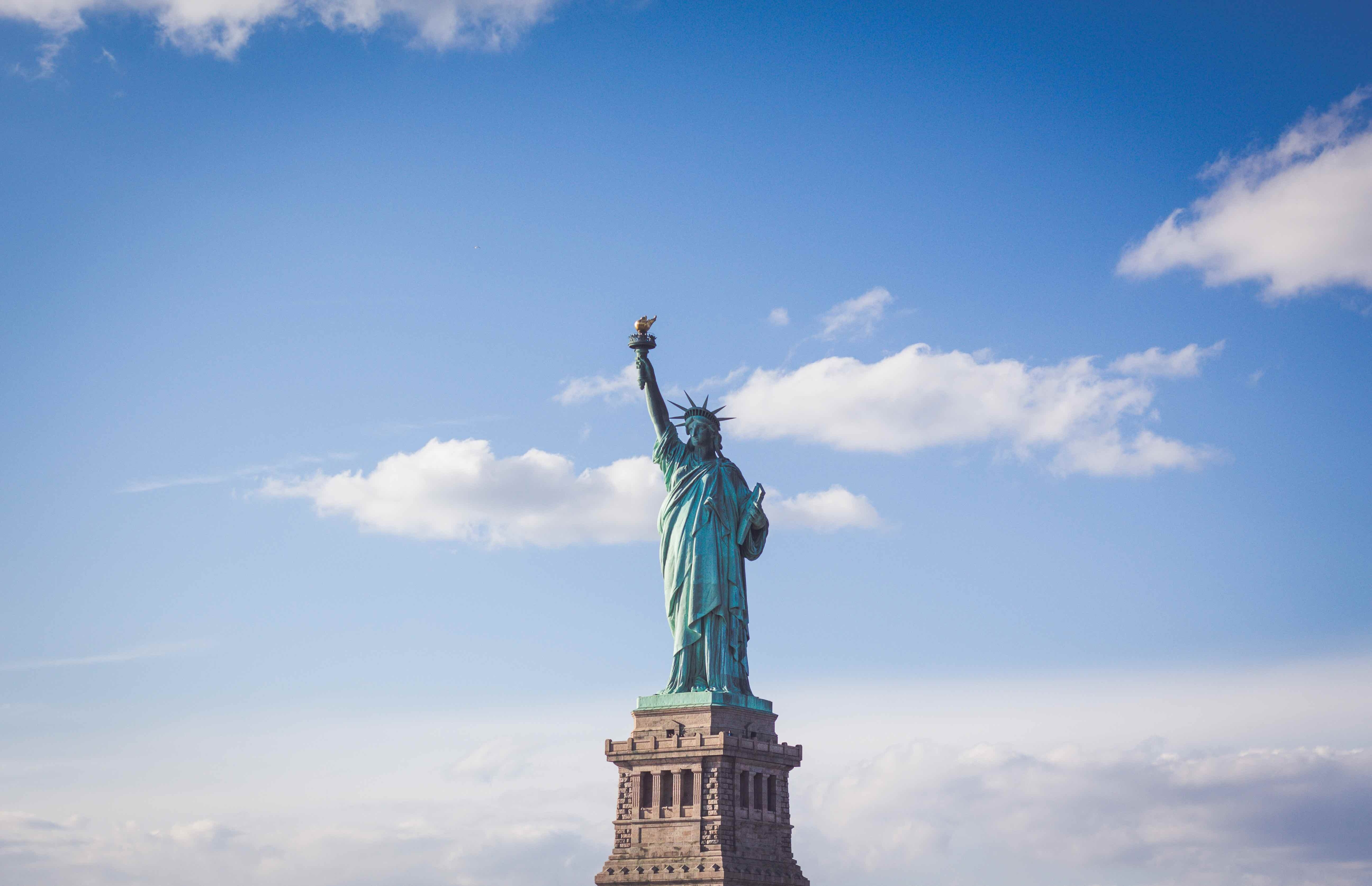 statue of liberty with sky backdrop